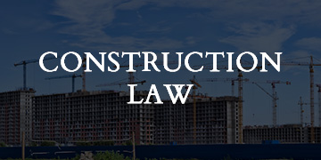 construction law text with tower cranes in background